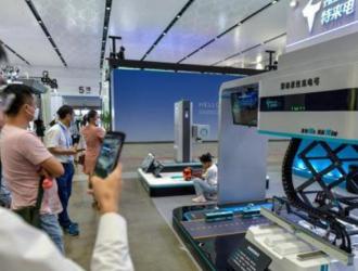 """世界新能源汽车大会""""黑科技""""汇聚 快速换电自动充电等设施抢眼"""